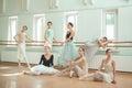 The seven ballerinas at ballet bar Royalty Free Stock Photo
