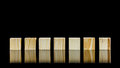 Seven blank wooden blocks row of on a black background with copyspace for your text letters or numbers Stock Photography