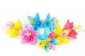 Seven colored paper flowers and flower with varicolored petals Stock Images