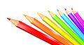 Seven colored pencils in a rainbow isolated over white. Royalty Free Stock Photo