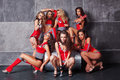 Seven Cute go-go sexy girls in red racing costume Royalty Free Stock Image