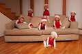 Seven little elves playing on a sofa Royalty Free Stock Photos
