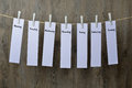 Seven sheets of paper hanging on a clothesline Royalty Free Stock Photo