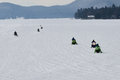Seven snowmobiles on lake pleasant two groups of crossing ny Stock Images