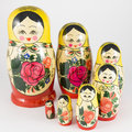 Seven traditional russian nesting dolls descending spiral on white background Royalty Free Stock Photo