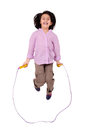Seven year girl jumping with skipping rope isolated on white this image has attached release Stock Image