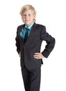 Seven years old blond schoolboy in school uniform, shirt and tie, hands on hips, isolated white background Royalty Free Stock Photo