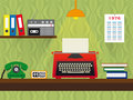 Seventies retro work place with typewriter telephone and cassette recorder vintage wallpaper background red green telepone radio Stock Photos