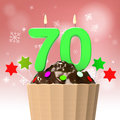 Seventy candle on cupcake shows elderly showing celebration or reunion Stock Images