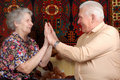 Seventy year old couple clap one`s hands Stock Photography
