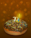 Seventy years birthday cake on brown background Royalty Free Stock Photos