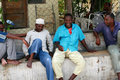 Several African men have a rest in the shade. Royalty Free Stock Photo