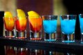Several alcoholic shots of diferent drinks at a party in nightclub on the counter Stock Photography