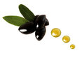 Several black olives with oil drops Royalty Free Stock Photography