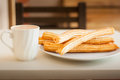 Several churros on small plate and milk with chocolate Royalty Free Stock Photo