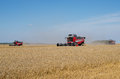 Several combine harvesters in the field lithuania Stock Photo