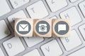 Several contact options as icon on little cubes on keyboard Royalty Free Stock Photo
