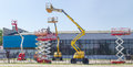 Several different scissor and articulated boom wheeled lifts Royalty Free Stock Photo