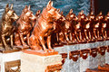 Several dogs gilded by hand on pedestal Royalty Free Stock Photos