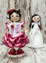 Several dolls doll with wedding and flamenco dress vertical surrounded by rusticbackground Stock Photo