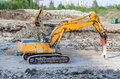 Several excavators on construction site Royalty Free Stock Image