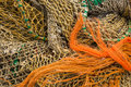 Several fishing nets in orange and brown Royalty Free Stock Images