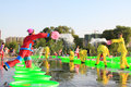 Several girls splashing water to play in the square, china Stock Photo