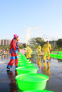 Several girls splashing water to play in the square, china Royalty Free Stock Photo