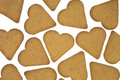 Several heart shaped ginger snap cookies white background Royalty Free Stock Image
