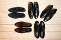 Several new pair of leather shoes for men on a wooden background with plenty free space the concept a business meeting or Royalty Free Stock Image