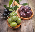 Several olives on wooden ground Royalty Free Stock Photo