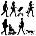 Several people on the street vector silhouettes Royalty Free Stock Photography
