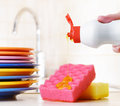 Several plates and a kitchen sponge dishwashing concept Stock Photography