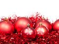 Several red Christmas balls and tinsel isolated
