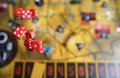Several rolling red dice fall on a table with boardgame gameplay moments Royalty Free Stock Photos
