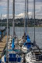Sailboats moored by the pier in White Rock, BC Royalty Free Stock Photo
