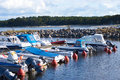 Several small motor boats moored in the small harbor on the Baltic sea Royalty Free Stock Photo