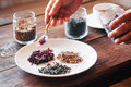 Several sorts of chinese herbal tea the waiter served a plate mound the different types hibiscus green on it Stock Photo