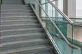 Several steps of granite stairs pattern with glass railing Royalty Free Stock Image