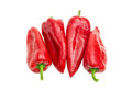 Several sweet red Kapia peppers on a light background Royalty Free Stock Photo