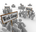 Several work groups of workers divided tasks many gathered in teams around signs with the words group to illustrate collaborative Royalty Free Stock Photos