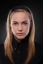 Severe teenage girl closeup portrait of wearing black looking at camera Stock Photos