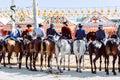 Group of riders on horseback at the April Fair, Seville Fair Feria de Sevilla. Royalty Free Stock Photo