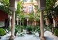 Traditional courtyard with columns, garden plants in historical house of Andalusia Royalty Free Stock Photo
