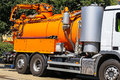 Sewage truck on the street in city Royalty Free Stock Photo