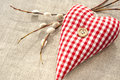 Sewed cotton love heart with spring willow twig homemade red indoor closeup Royalty Free Stock Image