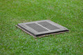 Sewer grate on the lawn - drainage for heavy rain Royalty Free Stock Photo
