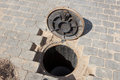 Sewer hole in a brick road Royalty Free Stock Photo