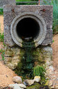 Sewer pipe on the beach concrete outlet in nature Stock Image