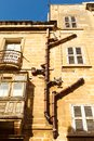 Sewer pipe on the facade of a residential building mediterranean europe Stock Photography